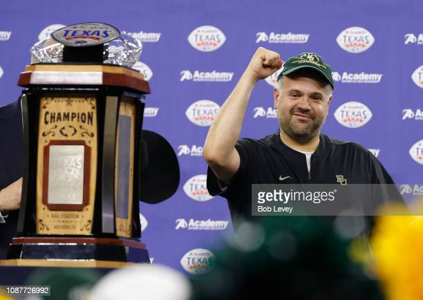 Head coach Matt Rhule of the Baylor Bears pumps his fist as the Robert C McNair Trophy after defeating the Vanderbilt Commodores during the Academy...