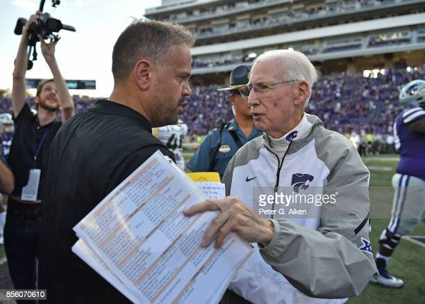 Head coach Matt Rhule of the Baylor Bears talks with head coach Bill Snyder of the Kansas State Wildcats after losing to the Wildcats on September 30...