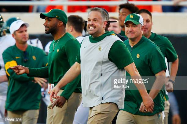 Head coach Matt Rhule of the Baylor University Bears grins as he heads onto the field after beating the Oklahoma State Cowboys on October 19 2019 at...