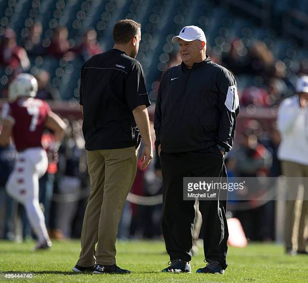 Head coach Matt Rhule of the Temple Owls talks to head coach Chip Kelly of the Philadelphia Eagles prior to the game against the Memphis Tigers on...