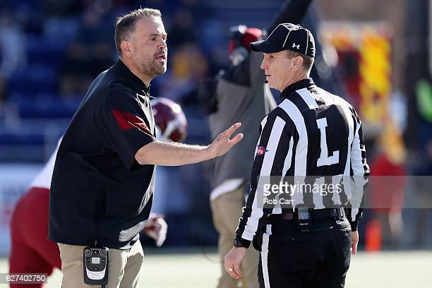 Head coach Matt Rhule of the Temple Owls talks with line judge Tod Reese during the first half of the against the Navy Midshipmen during the AAC...