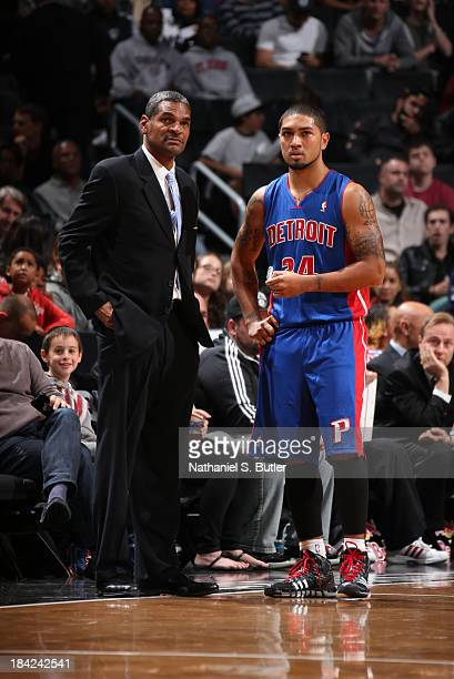 Head Coach Maurice Cheeks of the Detroit Pistons talks with Peyton Siva of the Detroit Pistons while playing in a preseason game against the Brooklyn...