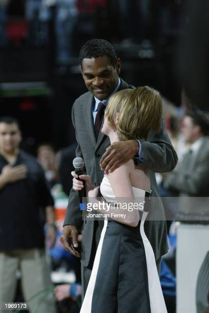 Head coach Maurice Cheeks of the Portland Trail Blazers assists Natalie Gilbert finish singing the National Anthem prior to the Portland Trail...