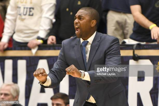 Head coach Maurice Joseph of the George Washington Colonials reacts to a call during a college basketball game against the Stony Brook Seawolves at...