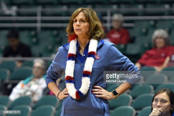 Head coach Megan Gebbia of the American University Eagles looks on during a Rainbow Wahine Showdown women's college basketball game against the...