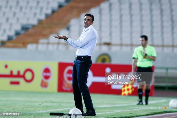 Head Coach Mehdi Rahmati of Padideh gestures during the Persian Gulf Pro League match between Esteghlal and Padideh FC at Azadi Stadium on June 21,...
