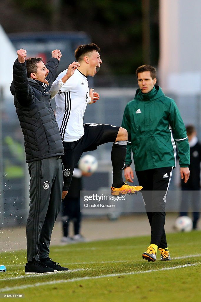 Head coach Meikel Schoenweitz and Renat Dadachov of Germany celebrate after winning 1-0 the U17 Euro Qualification match between Germany and Netherlands at Paul Janes Stadium on March 29, 2016 at Esprit-Arena in Duesseldorf, Germany.The match between Germany and the Netherlands ended 1-0 and Germany qualified for the U17 Euros.