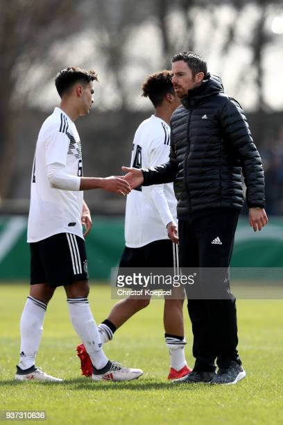 Head coach Meikel Schoenweitz of Germany comforts Atakan Akkaynak of Germany after the UEFA Under19 European Championship Qualifier match between...