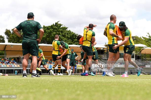 Head coach Mel Meninga watches on as players practice tackling during the Australian Kangaroos Rugby League World Cup training session at Langlands...