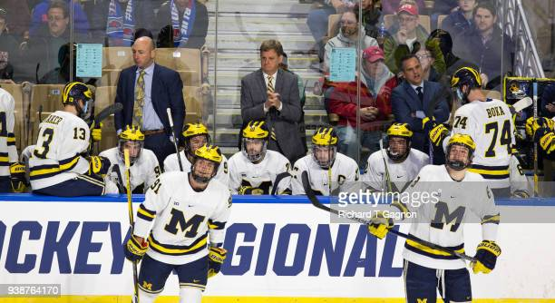 Head coach Mel Pearson of the Michigan Wolverines stands behind the bench during a game against the Boston University Terriers during the NCAA...