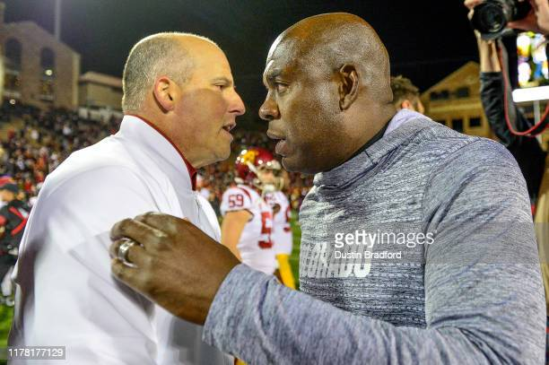 Head coach Mel Tucker of the Colorado Buffaloes and head coach Clay Helton of the USC Trojans meet on the field after the USC Trojans 3531 win over...