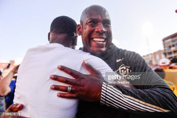Head coach Mel Tucker of the Colorado Buffaloes hugs a fan who had rushed the field after the Colorado Buffaloes 3431 overtime win over the Nebraska...