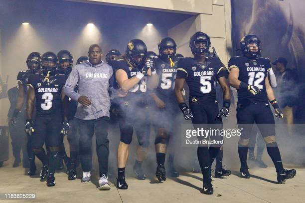 Head coach Mel Tucker of the Colorado Buffaloes leads players onto the field before a game against the USC Trojans at Folsom Field on October 25 2019...