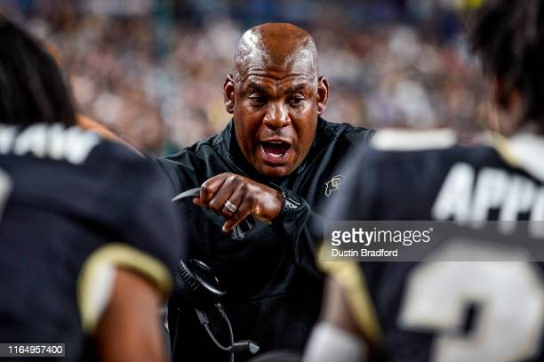 Head coach Mel Tucker of the Colorado Buffaloes talks to his team in the second half of a game against the Colorado State Rams at Broncos Stadium at...