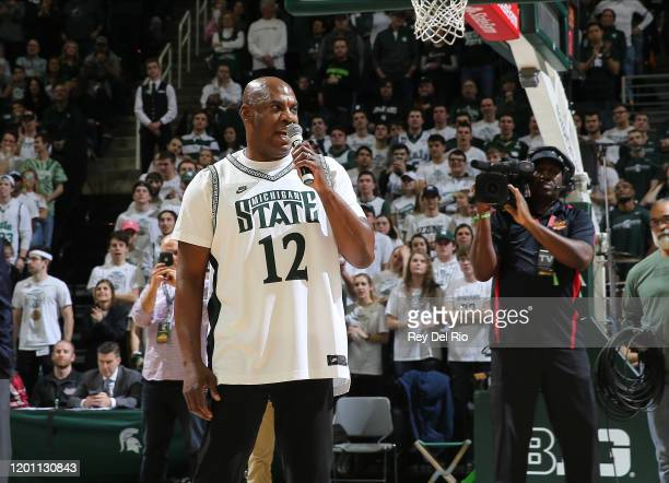 Head coach Mel Tucker of the Michigan State Spartans address the crowd during halftime of a college basketball game between the Michigan State...