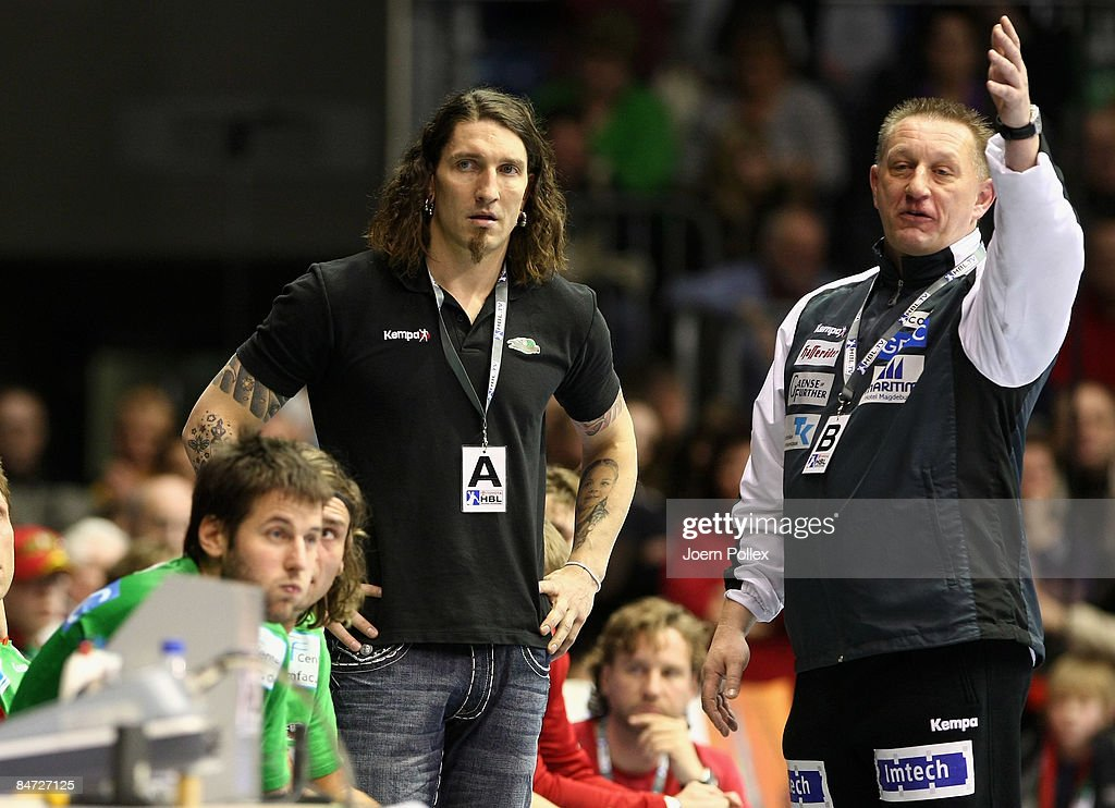 Head coach Michael Biegler (R) and teammanager Stefan Kretzschmar of Magdeburg gesture during the Toyota Handball Bundesliga match between SC Magdeburg and THW Kiel at the Boerdeland hall on February 10, 2009 in Magdeburg, Germany.