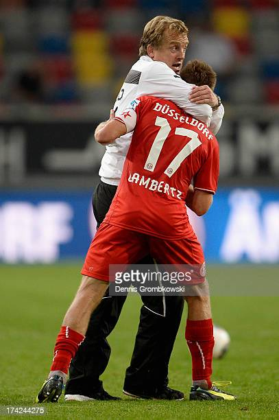 Head coach Michael Bueskens of Fortuna Duesseldorf celebrates with Andreas Lambertz after the Second Bundesliga match between Fortuna Duesseldorf and...