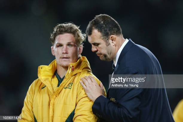 Head Coach Michael Cheika of the Wallabies consoles Michael Hooper after The Rugby Championship game between the New Zealand All Blacks and the...