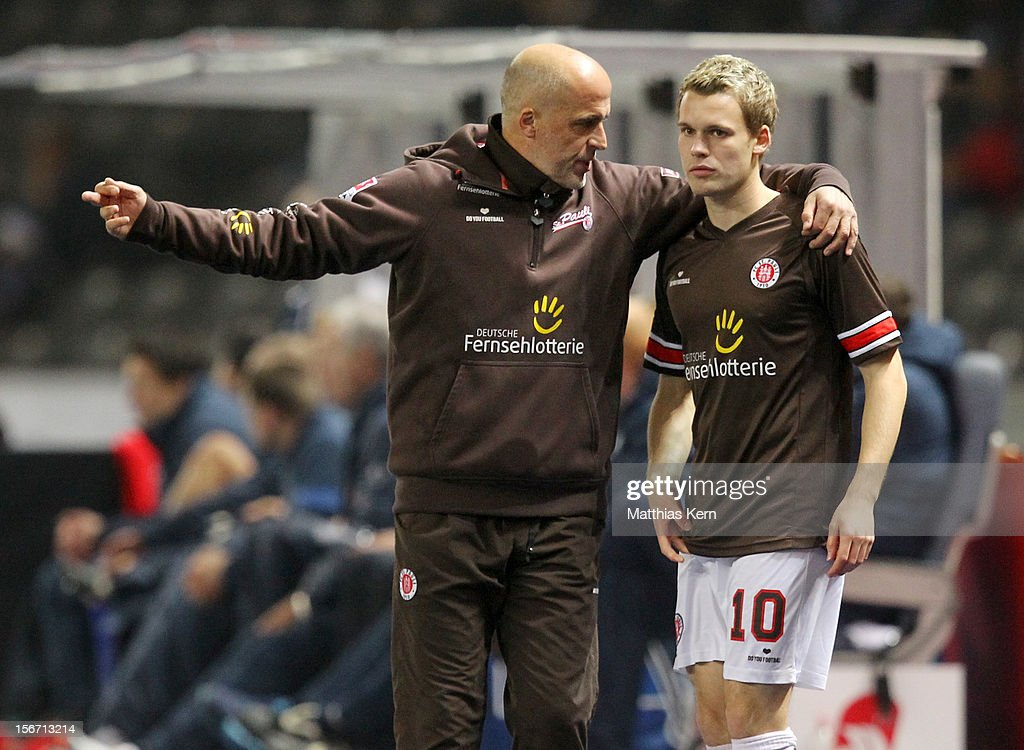 Head coach Michael Frontzeck (L) of St. Pauli talks with Christopher Buchtmann (R) during the Second Bundesliga match between Hertha BSC Berlin and FC St. Pauli at Olympic stadium on November 19, 2012 in Berlin, Germany.