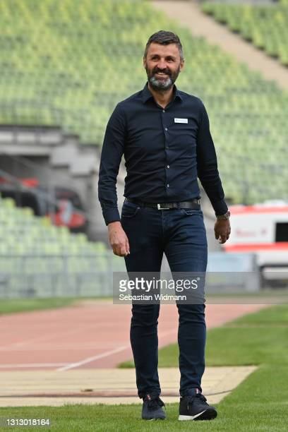 Head coach Michael Koellner of TSV 1860 München smiles prior to the 3. Liga match between Türkgücü München and TSV 1860 München at Olympiastadion on...