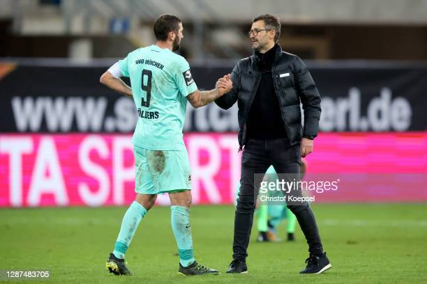 Head coach Michael Koellner of TSV 1860 Muenchen comforts Sascha Moelders of TSV 1860 Muenchen of TSV 1860 Muenchen after the 1-1 draw of the 3. Liga...