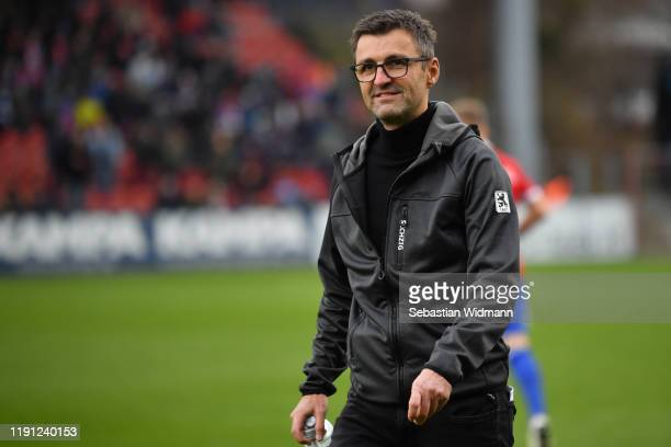 Head coach Michael Koellner of TSV 1860 Muenchen smiles prior to the 3. Liga match between SpVgg Unterhaching and TSV 1860 Muenchen at Alpenbauer...