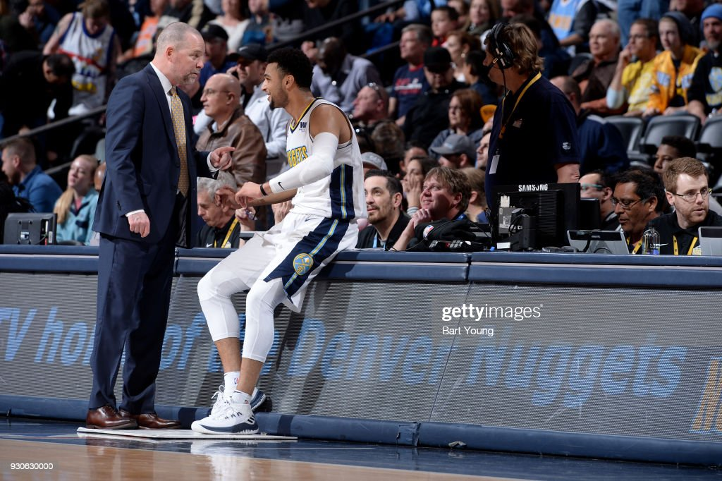 Head coach Michael Malone and Jamal Murray #27 of the Denver Nuggets speak during the game against the Sacramento Kings on March 11, 2018 at the Pepsi Center in Denver, Colorado.