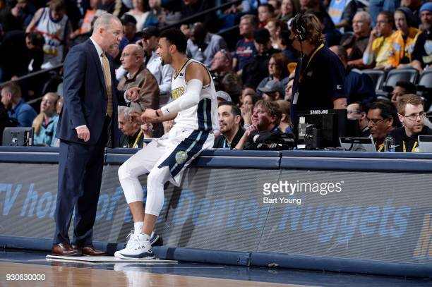 Head coach Michael Malone and Jamal Murray of the Denver Nuggets speak during the game against the Sacramento Kings on March 11 2018 at the Pepsi...