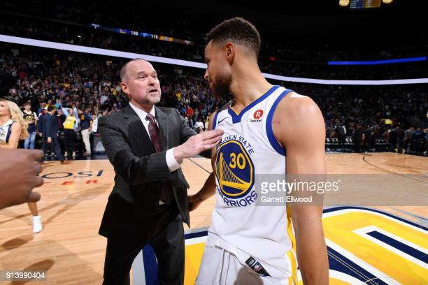 Head Coach Michael Malone of the Denver Nuggets and Stephen Curry of the Golden State Warriors talk after the game on February 3 2018 at the Pepsi...