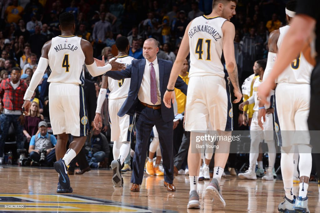 Head Coach Michael Malone of the Denver Nuggets high fives Paul Millsap #4 of the Denver Nuggets during the game against the Milwaukee Bucks on April 1, 2018 at the Pepsi Center in Denver, Colorado.