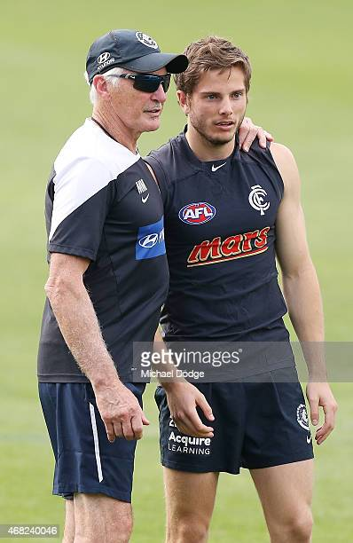Head coach Michael Malthouse hugs Jason Tutt during a Carlton Blues AFL training session at Ikon Park on April 1 2015 in Melbourne Australia