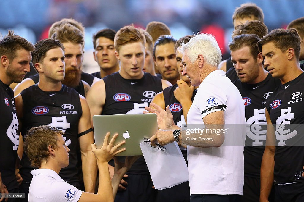 head coach Michael Malthouse of the Blues shows his players vision on the computer during the NAB Challenge AFL match between the Carlton Blues and the Geelong Cats at Etihad Stadium on March 22, 2015 in Melbourne, Australia.