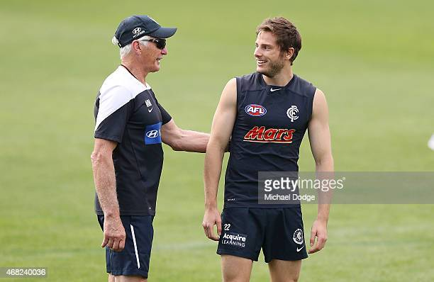 Head coach Michael Malthouse speaks to Jason Tutt during a Carlton Blues AFL training session at Ikon Park on April 1 2015 in Melbourne Australia