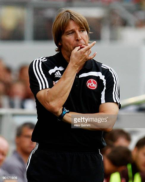Head coach Michael Oenning of Nuernberg whistles during the Bundesliga match between VfB Stuttgart and 1 FC Nuernberg at the MercedesBenz Arena on...