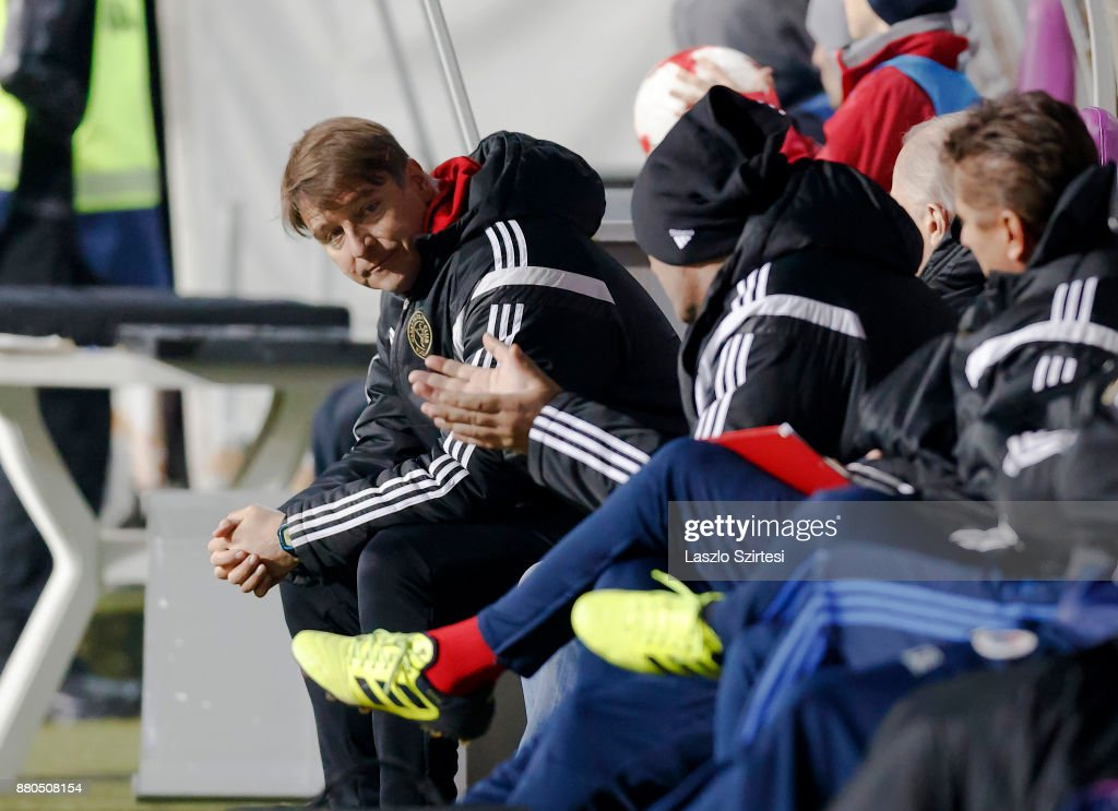 Head coach Michael Oenning (L) of Vasas FC sits on the bench very disappointed during the Hungarian OTP Bank Liga match between Vasas FC and DVSC at Ferenc Szusza Stadium on November 25, 2017 in Budapest, Hungary.
