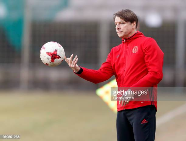 Head coach Michael Oenning of Vasas FC throws back the ball during the Hungarian OTP Bank Liga match between Vasas FC and Budapest Honved at Ferenc...