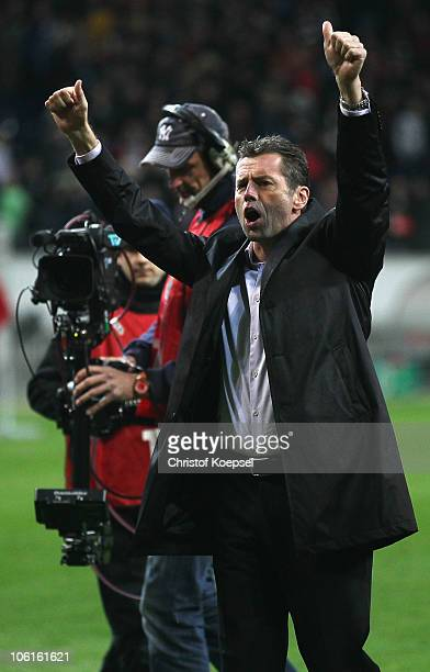 Head coach Michael Skibbe of Frankfurt celebrates the victory after the DFB Cup match between Eintracht Frankfurt and Hamburger SV at Commerzbank...