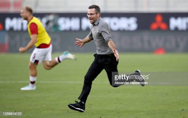 Head coach Michael Wiesinger of Nuremberg celebrtaes during the 2. Bundesliga playoff second leg match between FC Ingolstadt and 1. FC Nürnberg at...