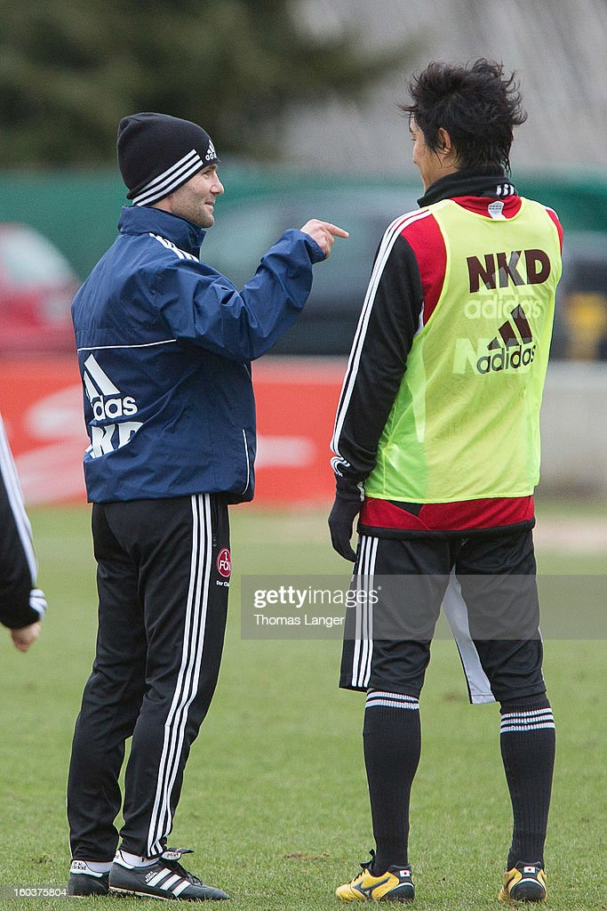 Head coach Michael Wiesinger speaks with new player Mu Kanazaki (R) of 1 FC Nuernberg during a training session on January 30, 2013 at the Sportpark Valznerweiher in Nuremberg, Germany.