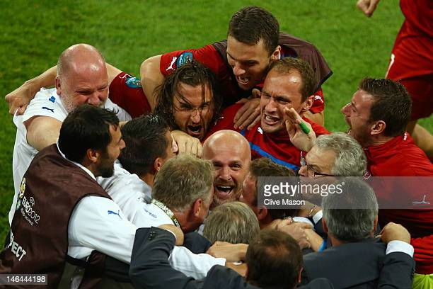 Head Coach Michal Bilek of Czech Republic is mobbed by players and staff at the final whistle during the UEFA EURO 2012 group A match between Czech...