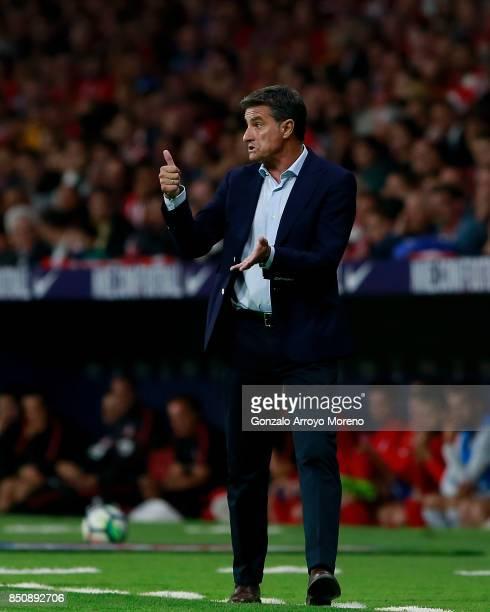 Head coach Michel Gonzalez of Malaga CF gives instructions during the La Liga match between Club Atletico Madrid and Malaga CF at Estadio Wanda...
