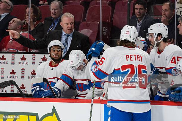 Head coach Michel Therrien of the Montreal Canadiens gives instructions to his players during the NHL game against the Boston Bruins at the Bell...