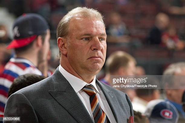 Head coach Michel Therrien of the Montreal Canadiens looks on from the bench during the warmup prior to an NHL preseason game against the Ottawa...