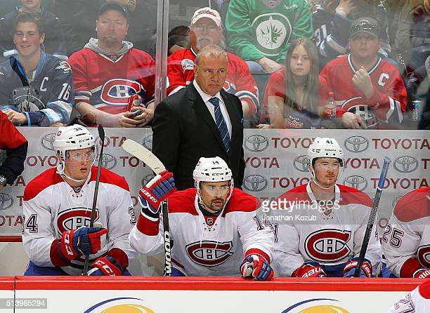 Head Coach Michel Therrien of the Montreal Canadiens looks on from the bench during third period action against the Winnipeg Jets at the MTS Centre...