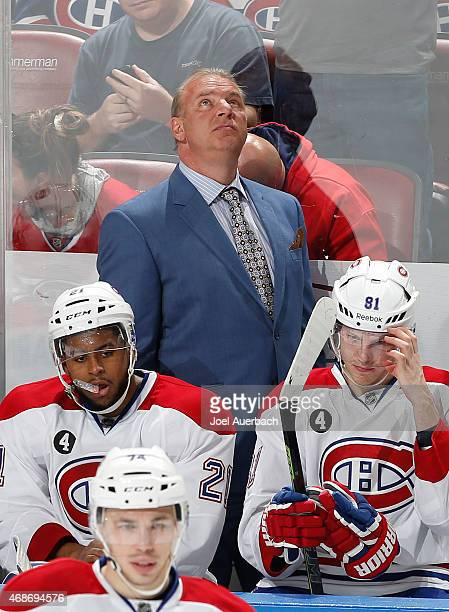 Head coach Michel Therrien of the Montreal Canadiens watches a replay during a break in action against the Florida Panthers at the BBT Center on...