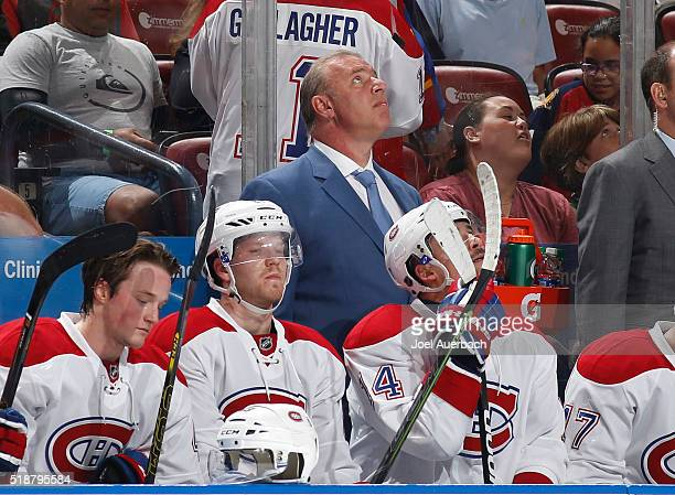 Head coach Michel Therrien of the Montreal Canadiens watches a replay of a goal that was disallowed against the Florida Panthers at the BBT Center on...