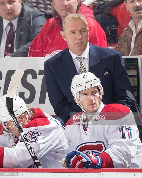 Head coach Michel Therrien of the Montreal Canadiens watches the action from the bench against the Detroit Red Wings during an NHL game at Joe Louis...