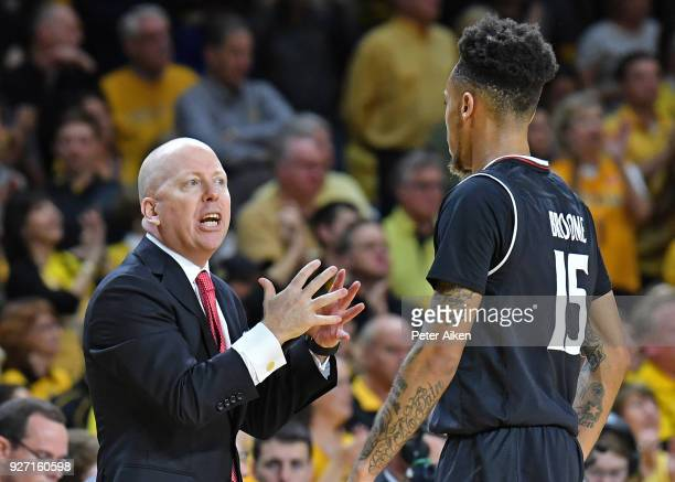Head coach Mick Cronin of the Cincinnati Bearcats instructs guard Cane Broome of the Cincinnati Bearcats during the first half on March 4 2018 at...