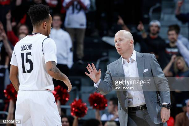 Head coach Mick Cronin of the Cincinnati Bearcats talks to Cane Broome in the first half of a game against the Coppin State Eagles at BBT Arena on...