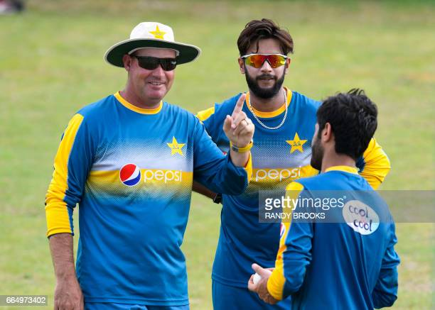 Head coach Mickey Arthur and Mohammad Nawaz of Pakistan take part in a training session at Guyana National Stadium in Providence on April 05 2017 in...